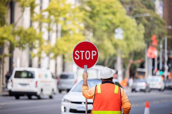 Traffic controller with stop slow sign